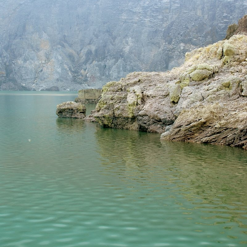 turquoise lake at bottom of Mount Ijen volcano crater, East Java, Indonesia