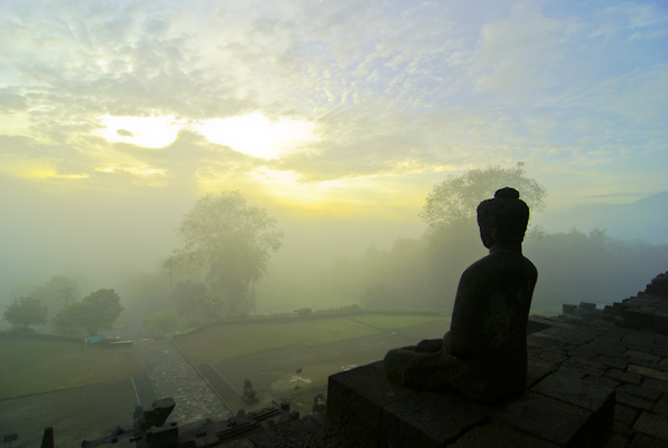 Buddha looking out from Borobudur