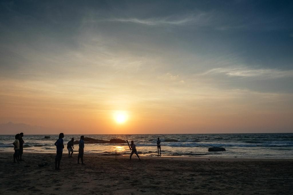 Beach cricket at sunset, Mount Lavinia, Sri Lanka.