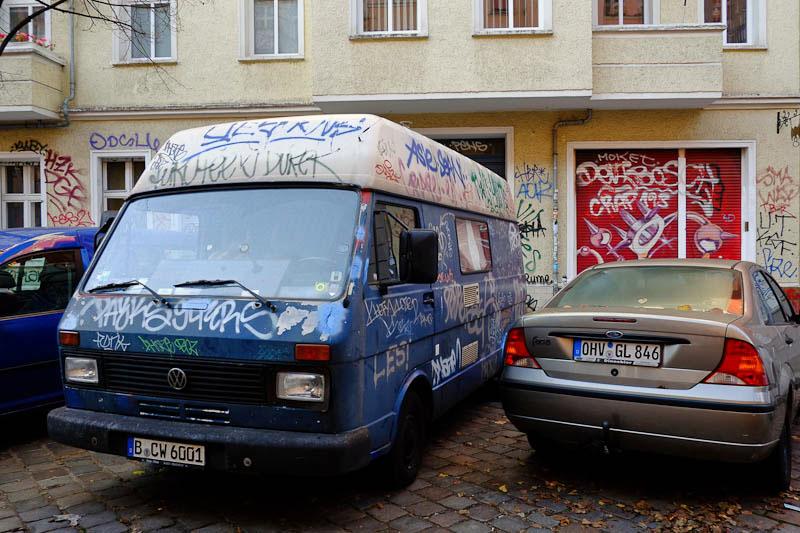 graffiti covered car -  Berlin