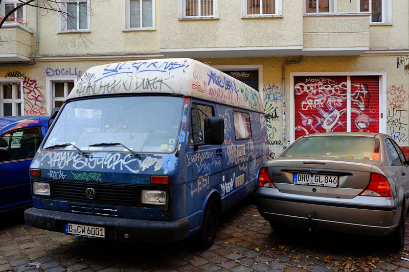 graffiti covered car -  Berlin