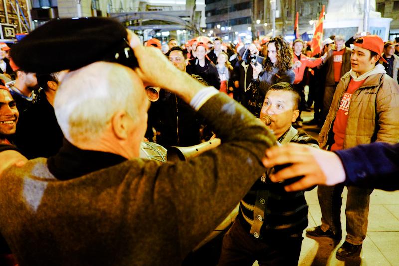Macedonian man has his hat blown away by musician in downtown Skopje.