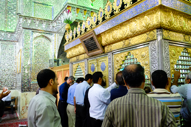 Kissing the Mausoleum at Shah Cheragh - on the other side, Phillipa is doing the same.