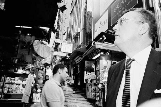 street photography hong kong  - man looks up