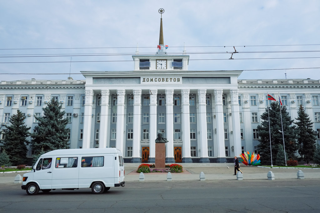 Transnistria, downtown Tiraspol. Lenin statue in front of Soviet style architecture.